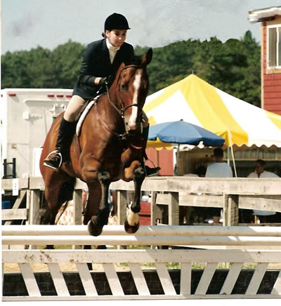 Melanie E. Scott and an OTTB she retrained as a show horse